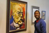 Fabien Diffé neben seinem Portrait des Nobelpreisträgers Robert Koch. Foto: Ernst