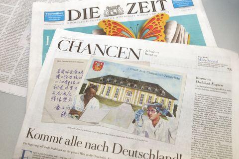 Der Artikel ist mit einer Grafik illustriert, die internationale Studierende vor der Clausthaler Aula zeigt. Foto: Ernst